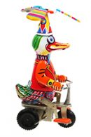 A vintage toy duck on a tricycle.